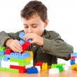 Little boy playing with plastic cubes — Stock Photo