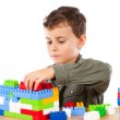 Little boy playing with plastic cubes — Stock Photo #2012028