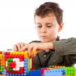 Little boy playing with plastic cubes — Stock Photo #2012030
