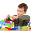 Little boy playing with plastic cubes — Stock Photo #2012050