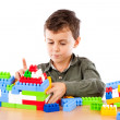 Little boy playing with plastic cubes — Stock Photo #2012053