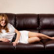 Beautiful blonde on a leather couch — Stock Photo #2012088