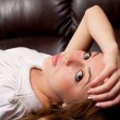 Beautiful blonde on a leather couch — Stock Photo #2012130