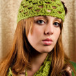 Beautiful blonde in retro cap and scarf — Stock Photo
