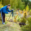 Stock Photo: Man using camcorder outdoors