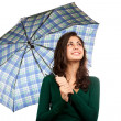 Young woman with umbrella - Stock Photo