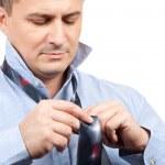Businessman adjusting tie knot — Stock Photo