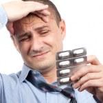 Businessman with headache — Stock Photo #2012665
