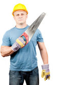 Blue collar worker with handsaw — Stock Photo