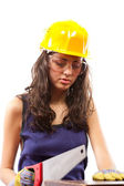 Latino construction lady with handsaw — Stock Photo
