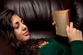 Young lady reading a vintage book — Stok fotoğraf