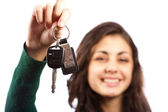 Young woman handing over car keys — Stockfoto