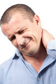 Młody biznesmen z bólem szyi — Zdjęcie stockowe