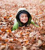 Cute kid playing outdoor — Stok fotoğraf