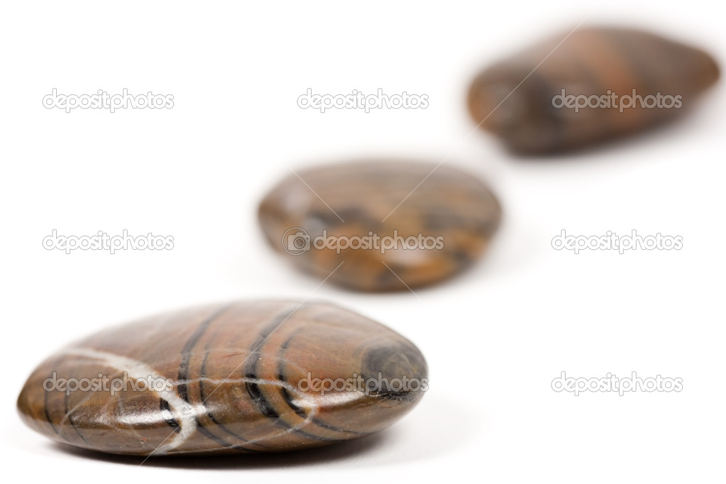 Close-up of shiny brown zen stones isolated on white background — Stock Photo #2012590