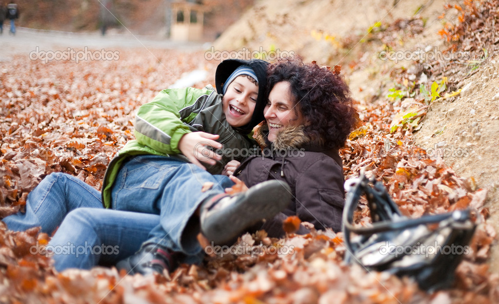 Mother and son having fun outdoor in a fine autumn day  Stock Photo #2013069