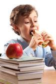 Schoolboy during lunch break — Stock Photo