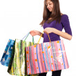 Foto Stock: Young lady with bags