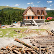 Building a house in mountains - Stock Photo