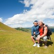Father and son hiking in the mountains - Foto Stock