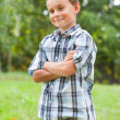 Cute kid outdoors in a grass field — Stock Photo #2210159