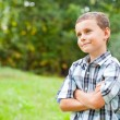Stock Photo: Cute kid outdoors in grass field