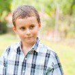 Cute kid outdoors in a grass field — Stock Photo #2210174
