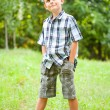 Cute kid outdoors in a grass field — Stock Photo #2210176
