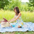 Stock Photo: Beautiful woman at picnic