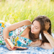 Beautiful woman reading outdoors — Stock Photo