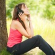 Young woman with headphones outdoor — Stock Photo