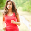 Woman jogging through a forest — Stock Photo