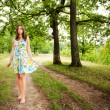 Barefoot woman walking in the forest — Stock Photo