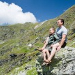 Father and son in the mountains - Stock Photo