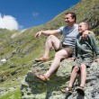 Stock Photo: Father and son in mountains