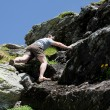 Strong man climbing mountain — Stock Photo