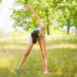Young woman doing aerobics outdoor — Stock Photo