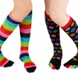 Legs with colorful stockings — Stock Photo
