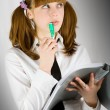 Girl writing in notebook — Stock Photo