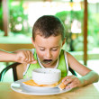 Stock Photo: Cute kid eating soup