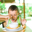 Cute kid eating soup — Stock Photo