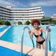 Woman in hotel's pool - Stock Photo