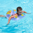 Cute kid swimming in pool — Stock Photo