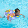 Cute kid swimming in pool - Foto de Stock  