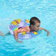 Cute kid swimming in pool - Stock Photo