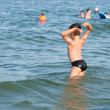 Boy playing in sea water — Stock Photo