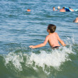 Boy playing in sea water — Stock Photo #2213745