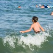 Stock Photo: Boy playing in sea water