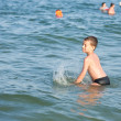 Boy playing in sea water — Stock Photo #2213773
