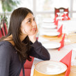 Brunette waiting in a restaurant — Stock Photo